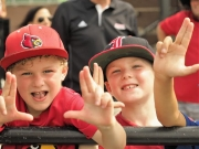 Once and future UofL fans with the L signs.