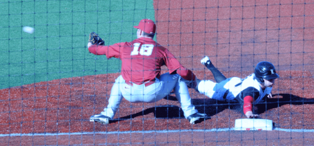 Adam Engel slides back into first base safely. He would steal a base in the 14th inning and score the winning run against Alabama when Cole Sturgeon got a bases-loaded walk.