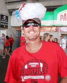 UofL fan Mike Schmidt cools off from the 90 degrees with a bag of ice.