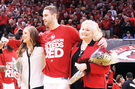 Luke Hancock is escorted by family and friends for his final game at the KFC Yum! Center.