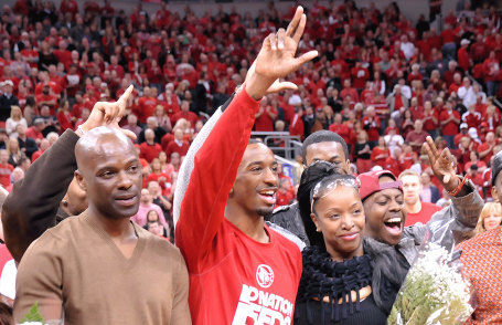 Russ Smith with his dad (left) and other family members.