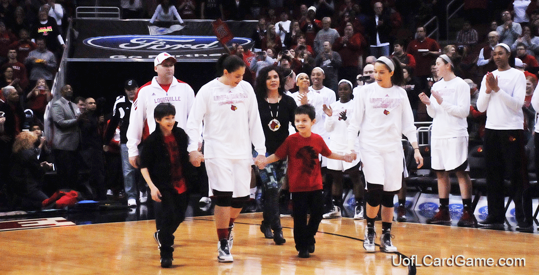 The Schimmel Family approaches center court for Senior Night ceremonies.