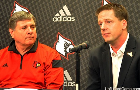 Tom Jurich, of the University of Louisville, and Chris McGuire, of Adidas, announce $40 million deal.