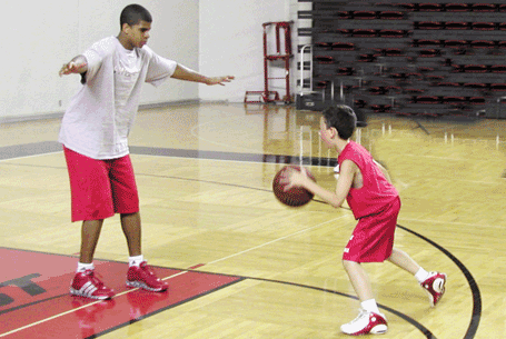 Edgar Sosa challenges the observer's grandson, Koby Springer, during a Rick Pitino summer camp in 2006.