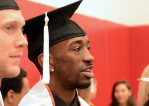 Tim Henderson and Russ Smith prepare for commencement ceremonies.