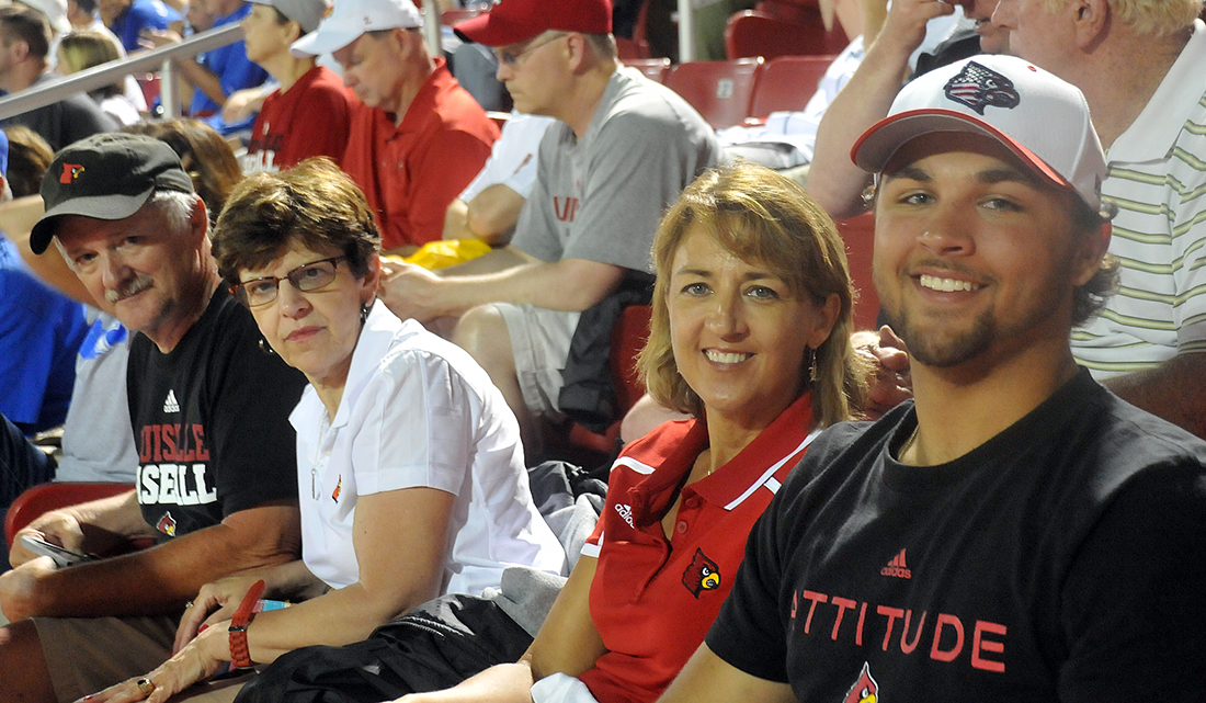 Colby Fitch (far right), with his mother Mary, watches NCAA Regional action. The couple to their left are Ray and Cheryl Stout who provided the tip to Card Game.