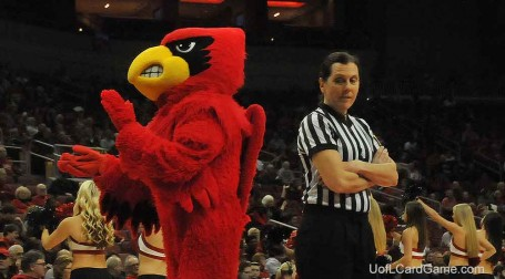 Susan Blauch, an ACC official, appears a bit skitish about the Cardinal Bird durng a break in the UofL-NC State game.