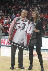 Jeff receives a commemorative framed photo from Christine Herring, senior women's administrator.