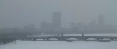 Still snowing and visibility remains low on the Charles River in Boston.