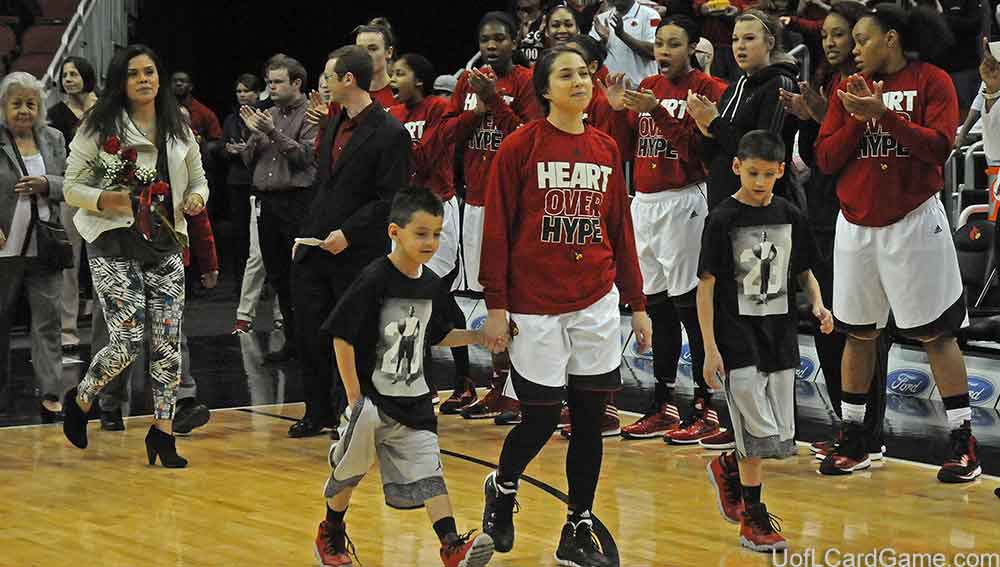 Jude Schimmel is hand-in-hand with her little brothers one last time at the KFC Yum! Center.