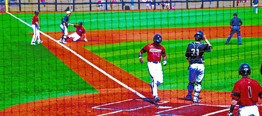 Corey Ray crosses the plate in a 10-1 win over Wake Forest in the first game.