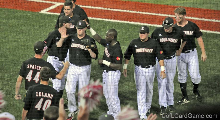 Josh Rogers is greeted by teammates after being lifted in the eighth inning with a 3-1 lead.