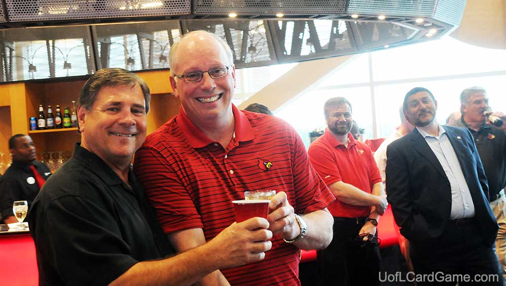 Tom Jurich and Kenny Klein raise a toast to their working relationship and friendship at the University of Louisville.