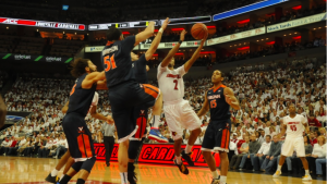 Quentin Snider takes on four Virginia defenders to no avail.