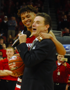 Damion Lee gets a commemorative ball from Rick Pitino for reaching the 2,000 point plateau.