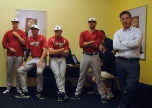 Former UofL baseball player Mark Jurich joins current players for the press conference.