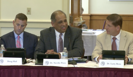 Acting President Neville Pinto is flanked by board members Doug Hall and Larry Benz.