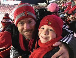 Andy and Eli Zehnder at Eli's first UofL football game (Photo by Charlie Springer).