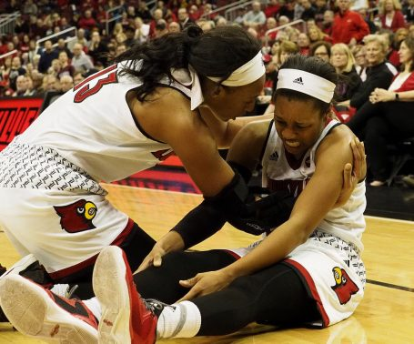 Cornee Walton (left) comes to the aid of Asia Durr after Asia suffers a cramp in Thursday's game against Maryland ( Cindy Rice Shelton photo).