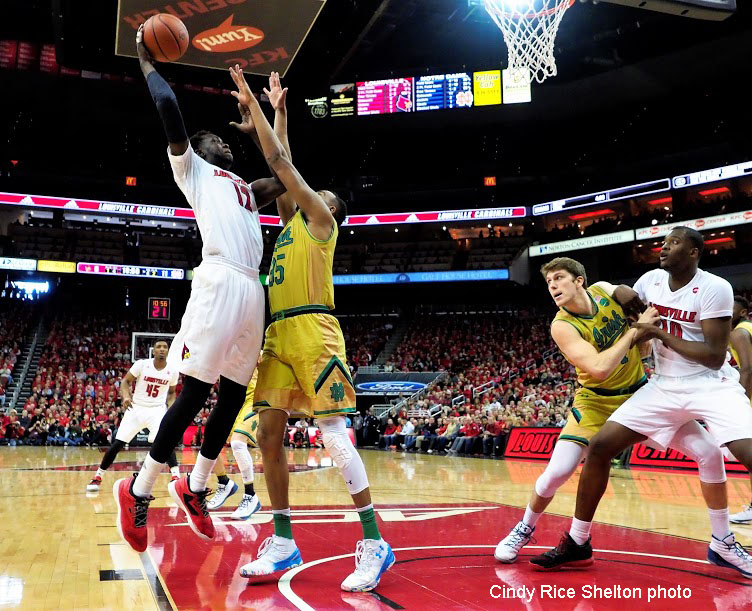 Mangok saves best for last, Louisville edges Notre Dame