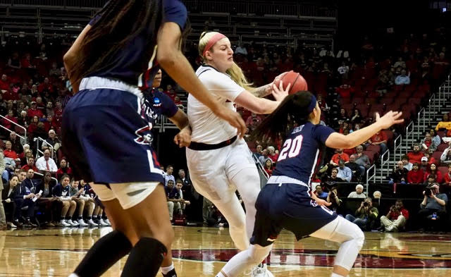 Walz has front row seat across street, Louisville women roll in NCAA opener