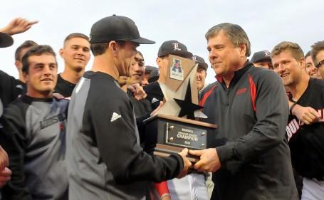 Tom Jurich delivers regular season AAC trophy to Dan McDonnell.