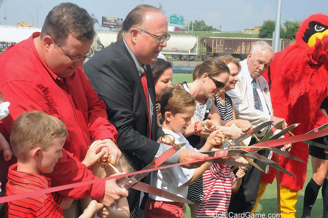 Mark Lynn (in dark suit) and family cut the ribbon. Twenty-one family members participated.