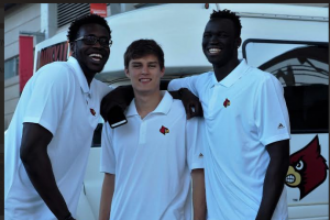 Mangok Mathiang, David Levitch and Deng Adel were with the UofL basketball team at the service.